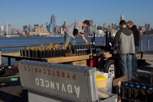 A fireworks company crew sets up for a fireworks show near new york city.
