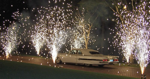 A car drives through close proximate fireworks during a PA wedding fireworks show.