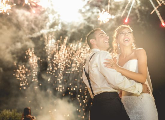 A bride and groom watch a NJ wedding fireworks show.