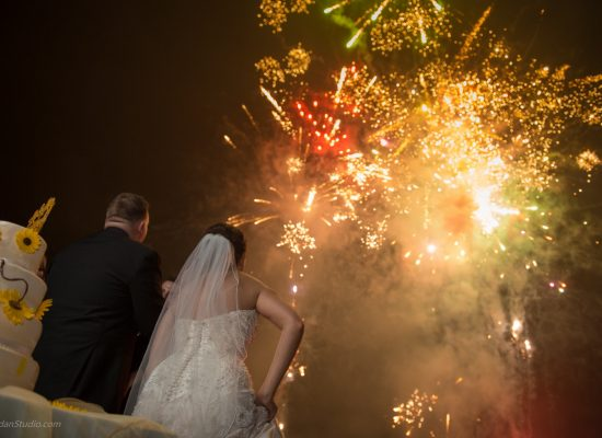 A bride and groom watch a PA wedding fireworks show.