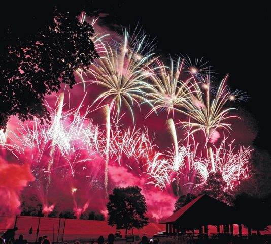 A beautiful display of fireworks over water during a PA fireworks show by a NJ fireworks company.