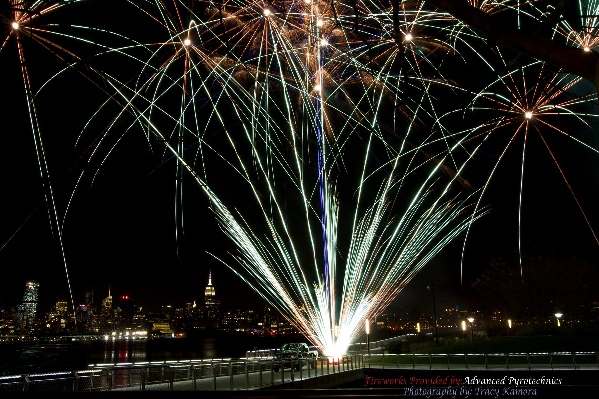 A silver fan cake ignites over the hudson for a show set up by a NJ fireworks company.